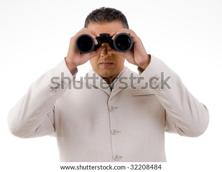 front view of businessman looking through binocular on an isolated background
