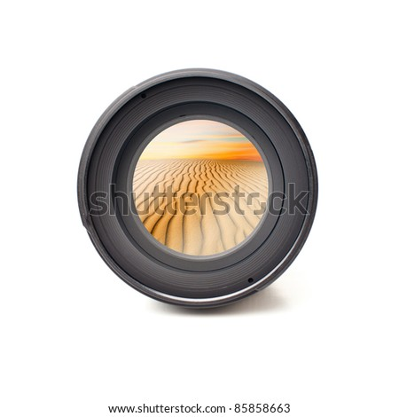 Front view of camera lens with desert landscape image reflection