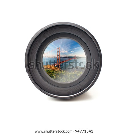 Front view of camera lens with Golden Gate bridge image reflection