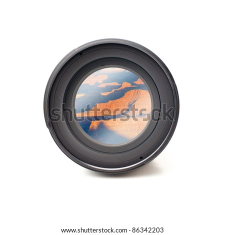 Front view of camera lens with grand canyon image reflection