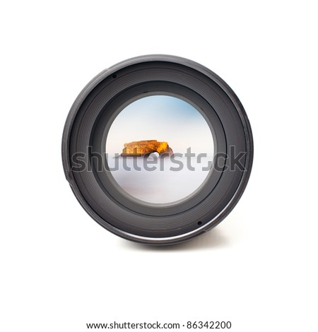 Front view of camera lens with ocean and mountain landscape image reflection