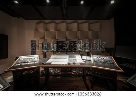 Front view of control desk in music studio room #1056333026