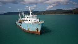 Front view of Decommissioned old fishing trauler anchored up of the coast of Koh Samu Island in Thailand