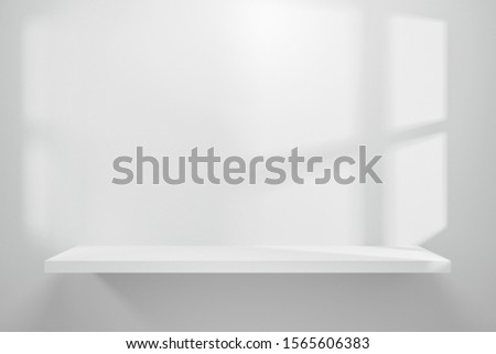 Front view of empty shelf on white table showcase and wall background with natural window light. Display of backdrop shelves for showing minimal concept. Realistic 3D render. Stock foto ©