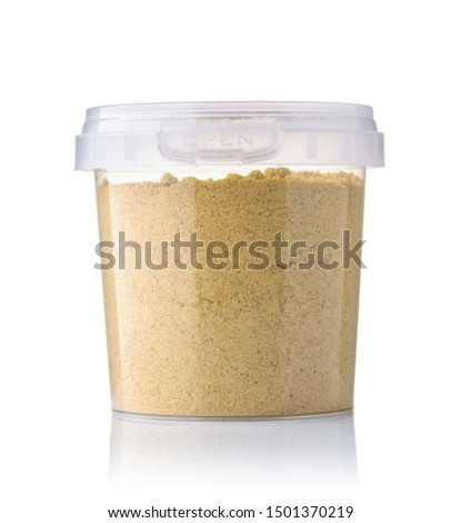 Front view of ginger powder in plastic jar isolated on white #1501370219