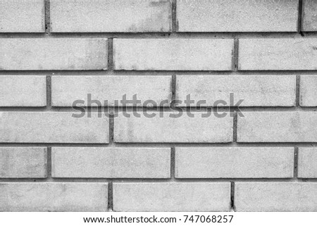 Front view of gray brick wall background and texture #747068257