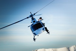Front view of helicopter in flight. Fly over the snow mountain.