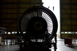 Front view of jet engine removed from aircraft (airplane) for maintenance and service all part and component .Jet engine maintenance at aircraft hangar by aircraft technician for safety.
