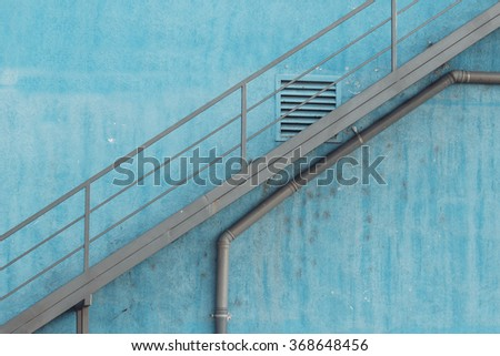 Front view of metal staircase on old blue building at industrial zone. #368648456