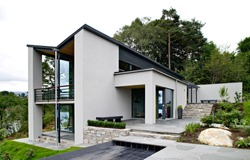 Front view of modern designed concrete residential house in western Norway