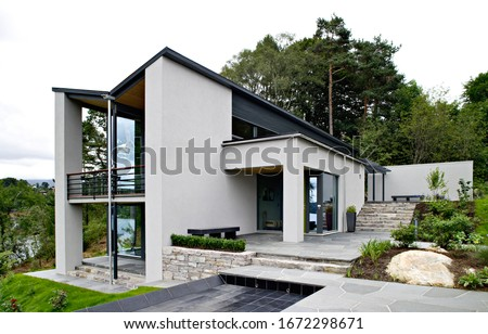 Front view of modern designed concrete residential house in western Norway ストックフォト ©