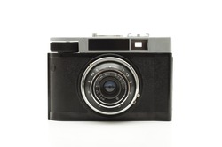 front view of old antique analog photo camera over white background