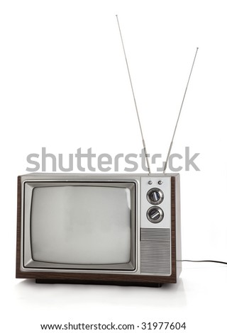 Front view of old television set with rabbit ears antennae on white background.