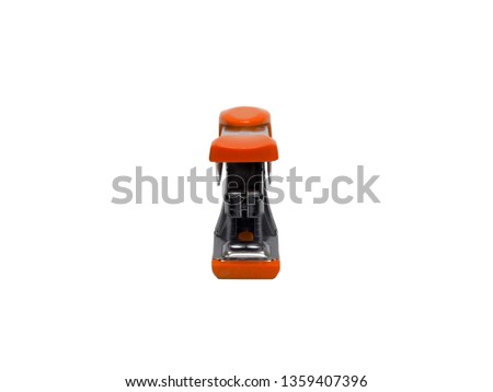 front view of orange stapler of office stationery  isolated on white background
