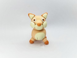 Front view of Plasticine statue  wolf character on a white background.