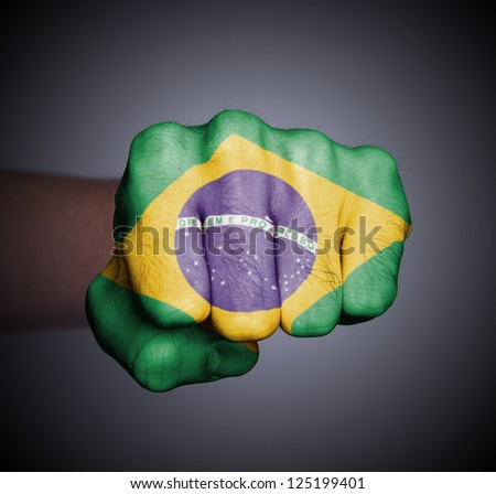 Front view of punching fist on gray background, flag of Brazil