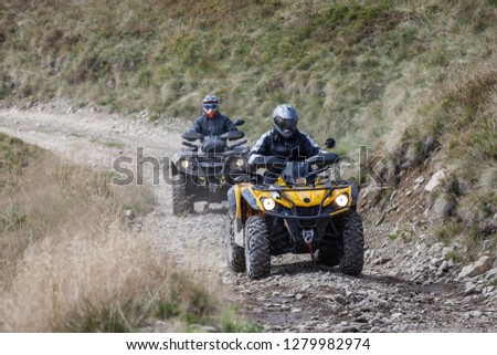 Front view of quad bikes zipping along a country road in Carpathian mountains, Ukraine. Stock photo ©