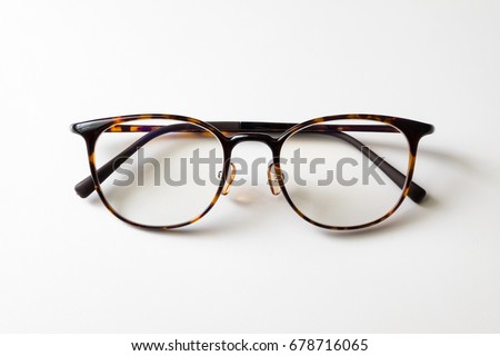 Front view of reading glasses with tortoiseshell frames on white background #678716065