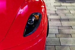 Front view of red ferrari and head lights