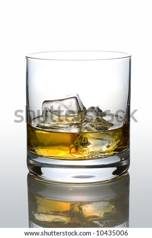 Front view of scotch glass on white reflective background