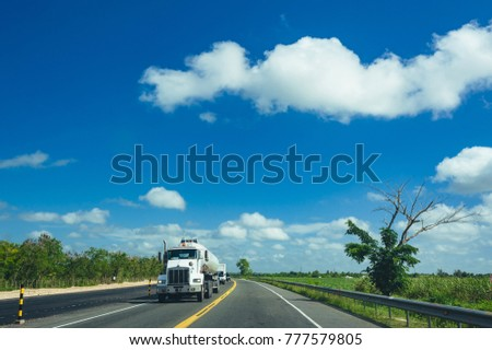 Front-View of Semi-Truck with Cargo Trailer Driving on a Highway #777579805