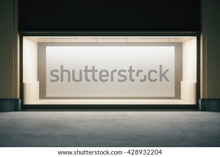 Front view of shop exterior with large banner in empty showcase at night. Mock up, 3D Rendering