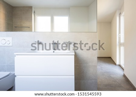 Front view of sink and mirror. Modern bathroom. Nobody inside