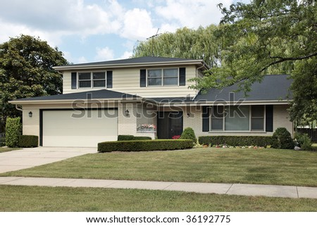 Front View Of Split Level Suburban Home Stock Photo