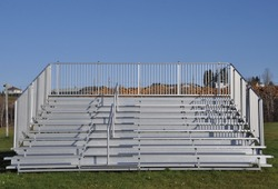 Front view of sturdy steel galvanized portable bleachers in the field