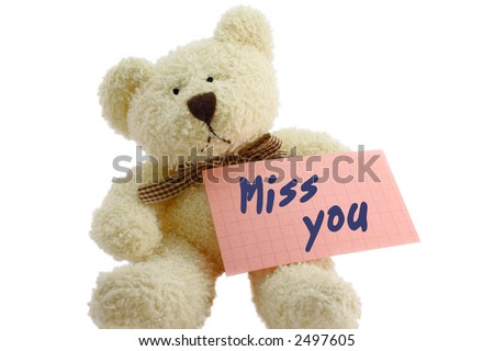 """Front view of teddy bear toy with """"Miss you"""" note, isolated on white background"""