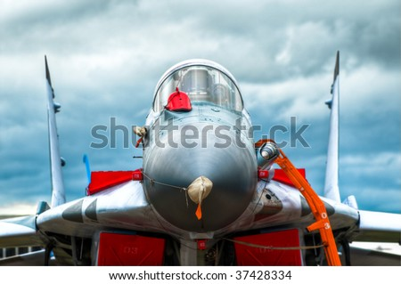 front view of the air fighter on the ground with blue sky in background