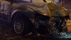 Front view of the car burned after the serious car accident at night in winter. High quality photo