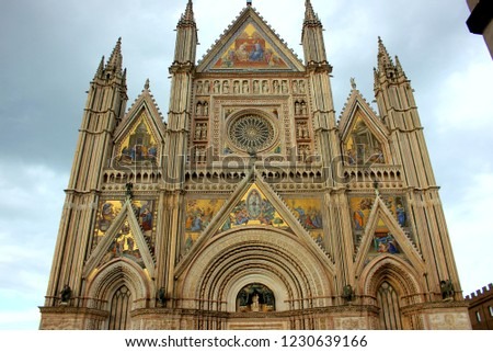Front view of the Cathedral of Orvieto Cathedral.The Cathedral of Orvieto is the cathedral of the Diocese town, Italian Gothic architecture.  #1230639166
