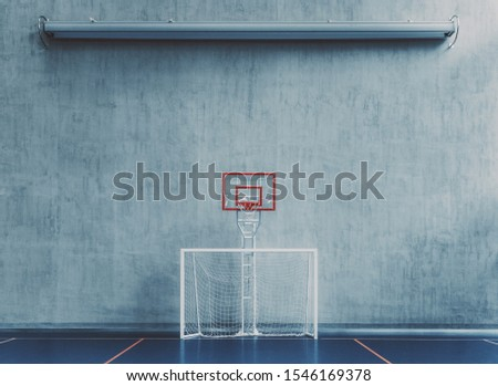 Front view of the court in the gym hall; an indoor modern office stadium with a basketball basket and hoop, football goal, blue floor, a concrete wall with an undeployed projection screen