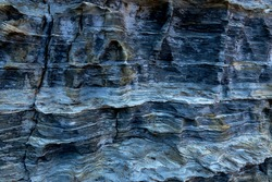 Front view of the effects of erosion, made by the wind and sea water, on a beautiful rock in blue tones. It seems that were painted by hand with great care. Clippings and fine textures. Pure Nature.