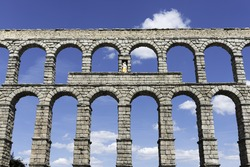 Front view of the famous Aqueduct bridge of Segovia on a clear Spring morning, a Roman aqueduct that is one of the most significant and well-preserved ancient monuments left on the Iberian Peninsula.