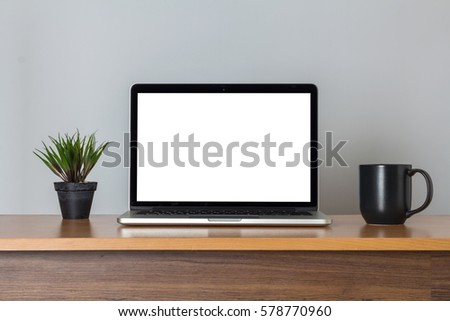 Front view of the laptop is on the work table, clipping path inside
