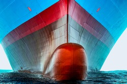 Front view of the large cargo ship bulbous bow, she is freshly painted.