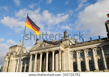 Front view of the Reichstag with german flags