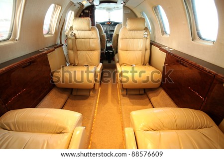 Front view of the small private jet cabin