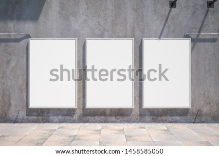 Front view of three empty white banners on outdoor concrete wall background. Mock up, 3D Rendering