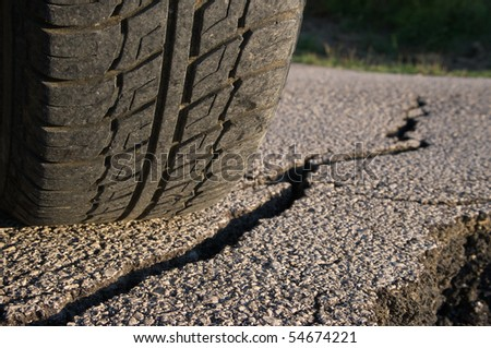 front view of tire tread and cracked asphalt stock photo 54674221 shutterstock. Black Bedroom Furniture Sets. Home Design Ideas