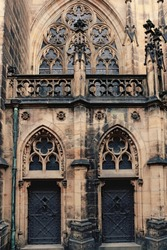 Front view of two twin medieval and gothc doors at the prague cathedral