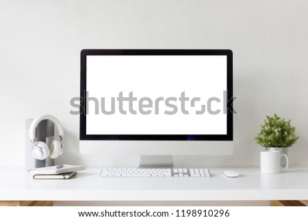 Front view office table desk. Workspace with blank computer screen, keyboard, mouse, booklets, pen, cup, headphones, books,plant mockup and white background #1198910296