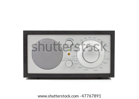 Front view on a classic radio, isolated over white background.