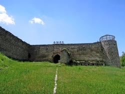 Front view onto Ganja Gate in Shusha, Nagorno-Karabakh. Gate is most best extant part of medieval fortress. Letters above wall translating as
