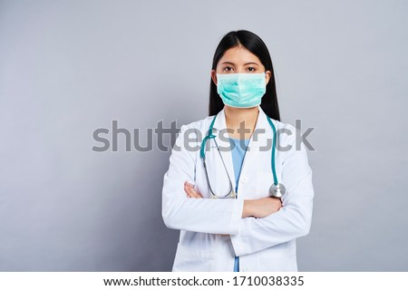 Front view portrait of Asian female doctor