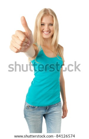 Front view portrait of beautiful young blond woman giving thumbs up over white background. Shallow deep of field, focus on the fist, big fist,wide angle view.