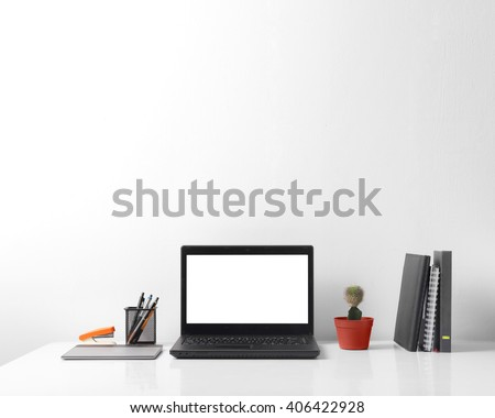 Front view portrait of modern person working area, over white background for copy space