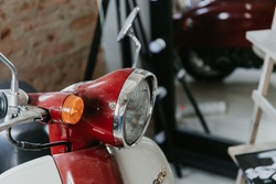 Front wing and headlight of red retro scooter, classic, transport, vintage bike